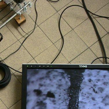 Vloer #1, 2016, robot + microcamera + scherm + ateliervloer